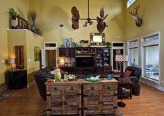 Living room.  Love that ceiling fan.