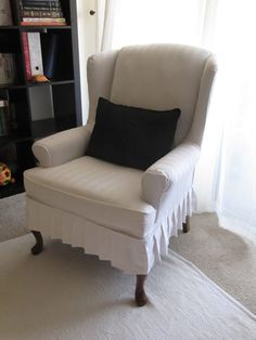 A homemade wing chair slipcover.  I would love to try this on one of our wingchairs! - HoneyBear Lane (great website)