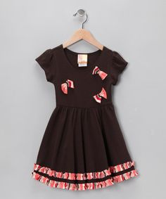 Playfully embellished with an assortment of leftover designer fabrics, this dress is eco-friendly with a vintage flair. Made in the USA, the soft-knit number has been carefully crafted to create an exclusive look.