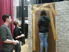 Students painting sets for SJHS' Godspell performance
