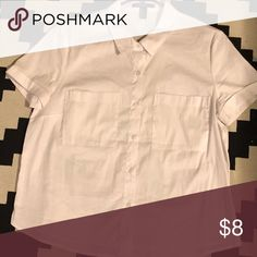 White Cotton Short Sleeve Blouse It's a slightly stretchy blouse so it's got comfort all while looking sleek and clean. The sleeves are cuffed for a cool 80's vibe.  It's not cropped but it's also not too long. Never worn. Tops