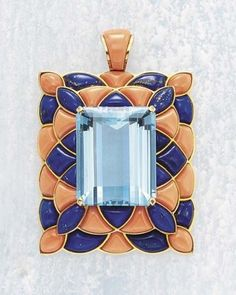 An Aquamarine Lapiz Lazuli and Coral Pendant CARTIER circa 1950 of rectangular design, center ing upon a rectangular-cut Aquamarine within a surround of cabochon Coral and lapis lazuli plaques,mounted in 18K yellow Gold , 4.5 x 3.6 cm. with jeweler'smark for 'CARTIER' and numbered. with French assaymarks