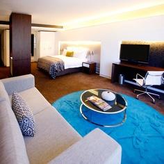 Deluxe Bedroom - African Pride 15 on Orange Hotel