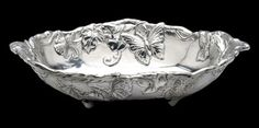 Arthur Court Designs Butterfly Oval - 12 inch by 8 inch polished aluminum - Food safe and tarnish free.  http://www.distinctive-decor.com/arthur-court-butterfly-oval-bowl.html