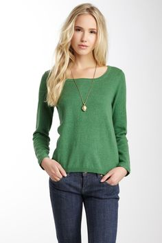 Love the color of this sweater. Nice and simple style too!