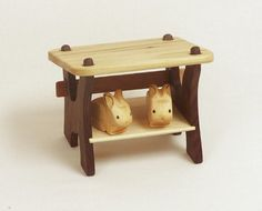Two sweet hand carved wooden bunnies in a hard wood bunny hutch toy made by TheAcornCap on etsy