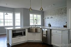 Complete Kitchen Makeover with painted cabinets and faux brick wall!