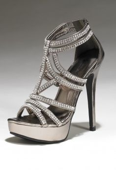 "This high heel platform sandal with zip back features:• 5.5"" heel• Zipper back• Non skid sole• 1"" platform"