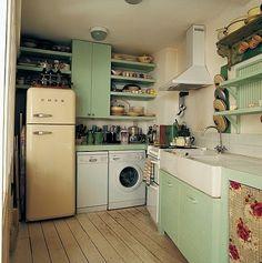 Pale green, wooden floors, ivory/rose red retro accessories, enamel saucepans