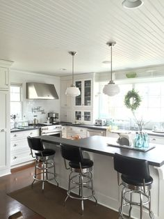 This white kitchen has such great details - the bead board ceiling, the school house lights ... eclecticallyvintage.com