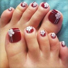 Big toe with flower and lines, rest of the toes with just lines. Colors: mint toes with black and white design (either white flower with black lines or vice versa)