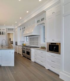 White Cape Cod Beach House Design The kitchen features shaker style cabinet with beaded face frame. White Shaker Kitchen Cabinets, Shaker Style Cabinets, Kitchen Cabinet Remodel, White Kitchen Cabinets, Kitchen White, White Kitchens, Glass Kitchen, Beautiful Kitchens, Cool Kitchens