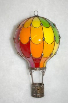 made from a light bulb. I think a mobil in a kids room out of these would be great, as loon as it was out of reach!