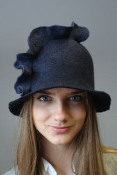 "Love this - it looks like a witch's hat gone over to the ""good"" side! Felted brim hat Wave by doseth on Etsy, €40.00"
