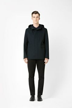 Green black cotton parka by Cos.