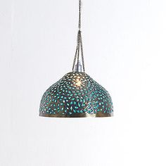 Metal bell pendant with indian-inspired cutouts--brass on outside, green on inside..  ps: have you ever heard of a room with NO light in it at all?!  welp, there's none in my bedroom or living room.. crazy, eh?!