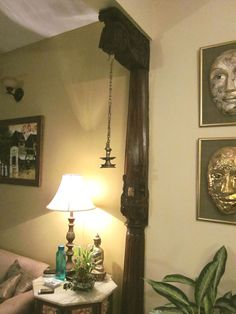 Hanging lamp attached to a wooden pillar. Sheila and Krishna Baru's home in Bengaluru Indian Home Interior, Indian Home Decor, Living Room Interior, Living Room Decor, Living Rooms, Decorating Blogs, Interior Decorating, Interior Design, House Pillars