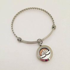 Lotus Flower Stainless Steel Aromatherapy Bracelet - Essential Oil Diffuser Bracelet - Aromatherapy Pendant - Essential Oil Bracelet  We are