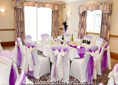 Cadbury purple and Ivory Tafetta Chair Sashes on Lycra covers. Centrepieces provided by the bridal florist.