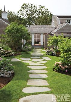Value - New England Home Magazine Landscape architect David Hawk planted lush perennial beds along a meandering bluestone path.Landscape architect David Hawk planted lush perennial beds along a meandering bluestone path.