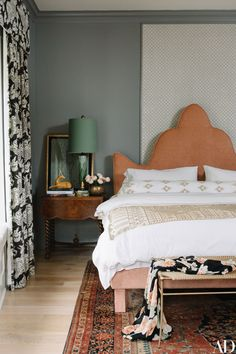 This bedroom is basically my idea of perfection. It's stylish yet lived in, refined yet cozy. The mix of patterns is so freaking on point. And I love the combination of blush pink, rust, navy and green. So very good. Boho, rock and roll bedroom style for the win.