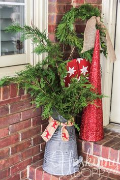 Christmas Porch decorating ideas with an old coal scuttle.  Post includes video tutorial on how to make the evergreen wreath. #christmas #wreath #voiceityall
