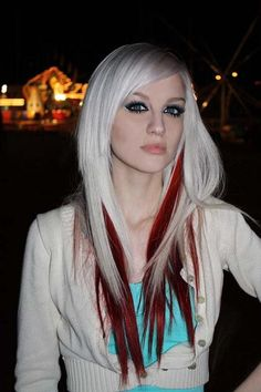 Platinum blonde hair with red streaks.