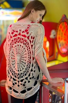 The giant wheel motif in the center of this crochet top is stunning. Wonder Wheel