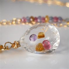 Gemstone Filled Crystal with Amethyst Citrine by YourDailyJewels, $144.00  How'd she do that?