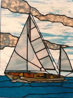 With the effect stained glass provides—light coming through it that looks like the surface of water—nautical scenes fit perfectly. Gibertson's Stained Glass - www.stainedartglass.com