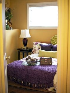 yellow and purple living dining room theme