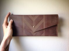 Laser etched leather clutch, by Tactile Craftworks. Milwaukee, Wisconson.