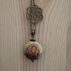Sautoir fantaisie avec perle en porcelaine bombée de 28mm de diamètre