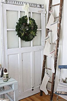 hanging stockings from a ladder..great idea!