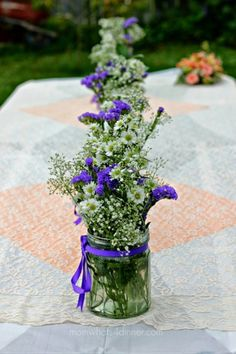 Flowers in Jars in a Row