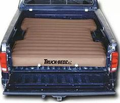 Truck beds designed an air mattress that fits in the bed of tour truck around the wheel hubs. Amazing idea!