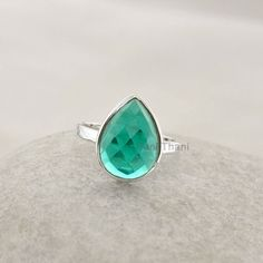 Teal Quartz Ring Faceted Pear 10x14mm Gemstone Ring 925 Sterling Silver Bezel Ring Jewelry - #1049 ******************************************************* Item Code: 1049  Metal: 925 Sterling Silver  Plating : Sterling Silver Stone Detail : Teal Quartz (Lab Created), Pear, 10x14mm ********* Lowest Price Guaranteed *********  As the fascination of making your own jewelry shows your individuality, your taste, and your creation, jewelry making with beautiful and colorful gemstones and sparkling…