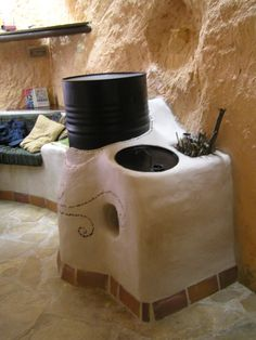 In the country of Catalunya, in the mountains of Alt Camp, located just outside the village of Pont d& is a family-owned . Build A Rocket, Rocket Mass Heater, Earth Bag Homes, Old Fireplace, Fireplaces, Stove Hoods, Stove Heater, Unusual Homes, Rocket Stoves