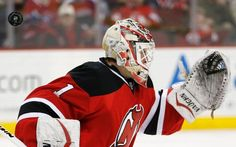 New Jersey Devils goalkeeper Keith Kinkaid (1) deflects a shot from the Montreal Canadiens during the first period of an NHL hockey game, Friday, April 3, 2015, in Newark, N.J. (AP Photo/Julio Cortez)