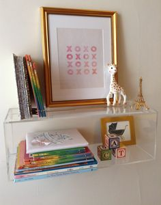 Beautifully-styled lucite shelf, complete with Sophie the Giraffe!