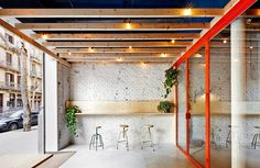 like this semi-outdoor transition space at the entrance to the bar (oval bar in barcelona by flexoarquitectura via remodelista)