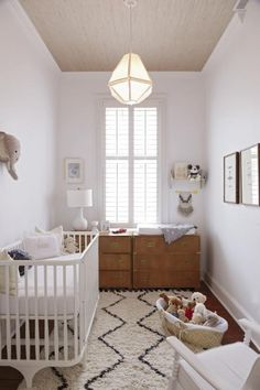Neutral nursery -- bring in more splashes of colour and it could be a room for a girl or a boy