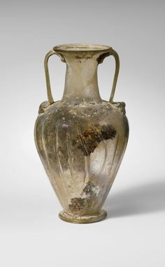 Glass jar with two handles (amphora). Period: Late Imperial. Date: 3rd century A.D. Culture: Roman.