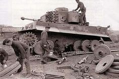 Very detailed photo of major running gear overhaul being done to this Tiger 1 by a maintenance crew.