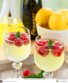 lemonade with frozen raspberries. Would be good w strawberries toi! so refreshing for that garden party.  The raspberries look like a flower. you could Also put a blueberry in the center of the raspberries.