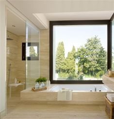 A marble bathroom open to the landscape ElMueble.com · · Kitchens and bathrooms