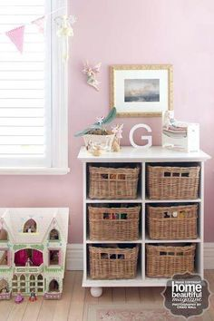 Such a gorgeous little toy nook for a girls bedroom.  This system can be used in all sorts of rooms in the house - bedrooms, laundry, bathroom, kitchen. The key is to label the baskets so you know what's in each. Love it! #clutter #organising #kids #children