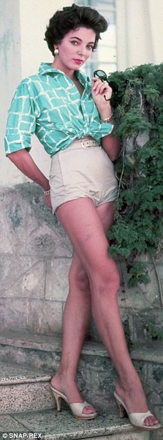 Joan Collins as a pin-up in 1957...