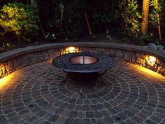 Circular fire pit patio with seating wall and lighting.  Designed and installed by Blessing Landscapes.  www.blessingland.com