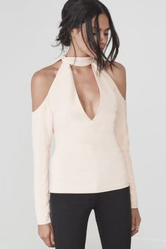 A cool addition to a V-neck or neutral knit, the style crowd are all over choker tops right now. The flash of skin around the décolletage adds a bit of suggestive detailing, whilst a choker neckline references the cool-girl jewellery trend.